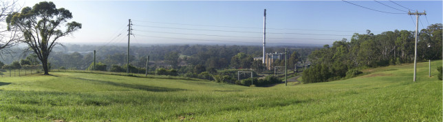 Looking east from Casula Green over the existing railway toward the Powerhouse. The Casula Viaduct would run behind the Powerhouse toward the left. Image: Wikipedia